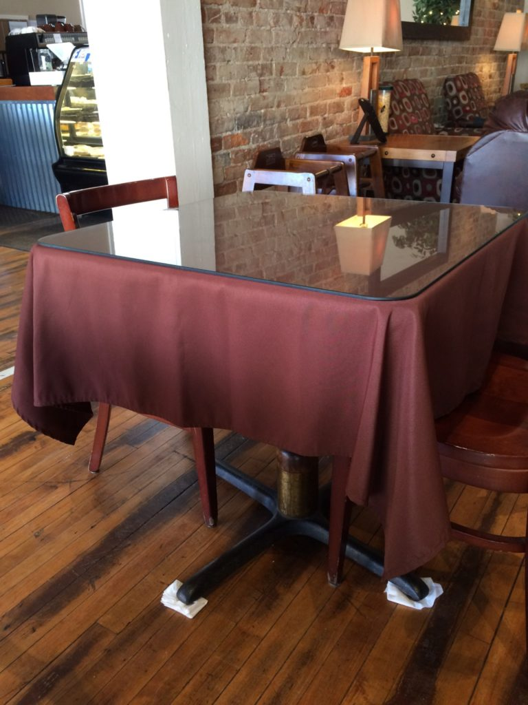 Wobbly table with napkins